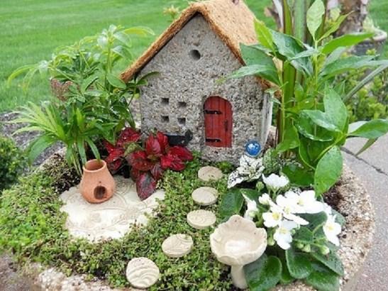 Fotos de mini jardines con casitas